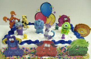 "Disney's Monster's Inc. Adorable 16 Piece Cake Topper Set Featuring Sulley, Boo, Mike Wazowski, Randall Boggs, Various Monster Birthday Cake Cutouts, CDA  Monster Inc. Characters Range from 2"" 3"" Tall and 2 Monster Inc. Themed Cake Decora"