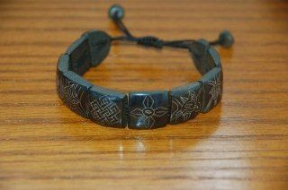 Carved Dark Yak Bone Bracelet with Eight Auspicious Symbols