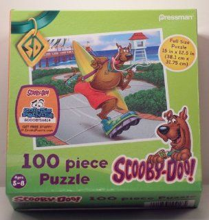 Scooby Doo! Scooby Rollerblading at the Beach 100 piece puzzle: Toys & Games