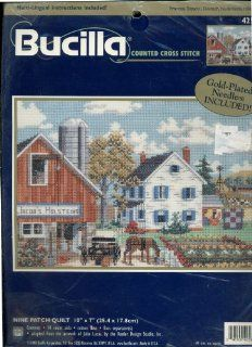 Bucilla Counted Cross Stitch Kit Nine Patch Quilt Adapted From the Artwork of Julia Lucas Features a Farm With a Horse and Carriage in the Foreground Next to a Garden and a Red Barn 10 by 7 Inches